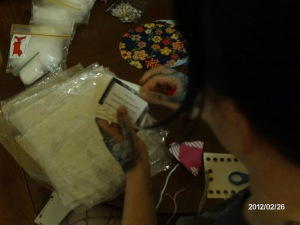 Putting together the components for the 100% Recycled Materials Pincushion kits