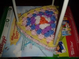 stretching pastel wool granny squares