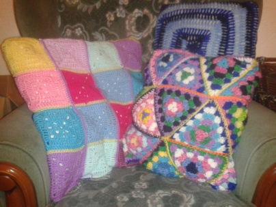 crocheted granny square pillow set