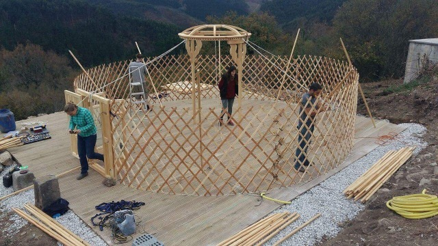 Lattice and first yurt door with chalk outline