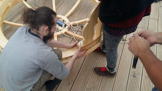 Bolting crown to stand building a yurt